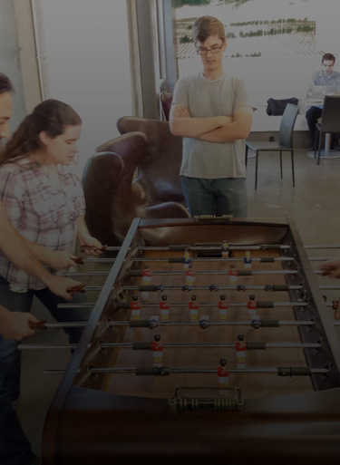 WA team playing foosball